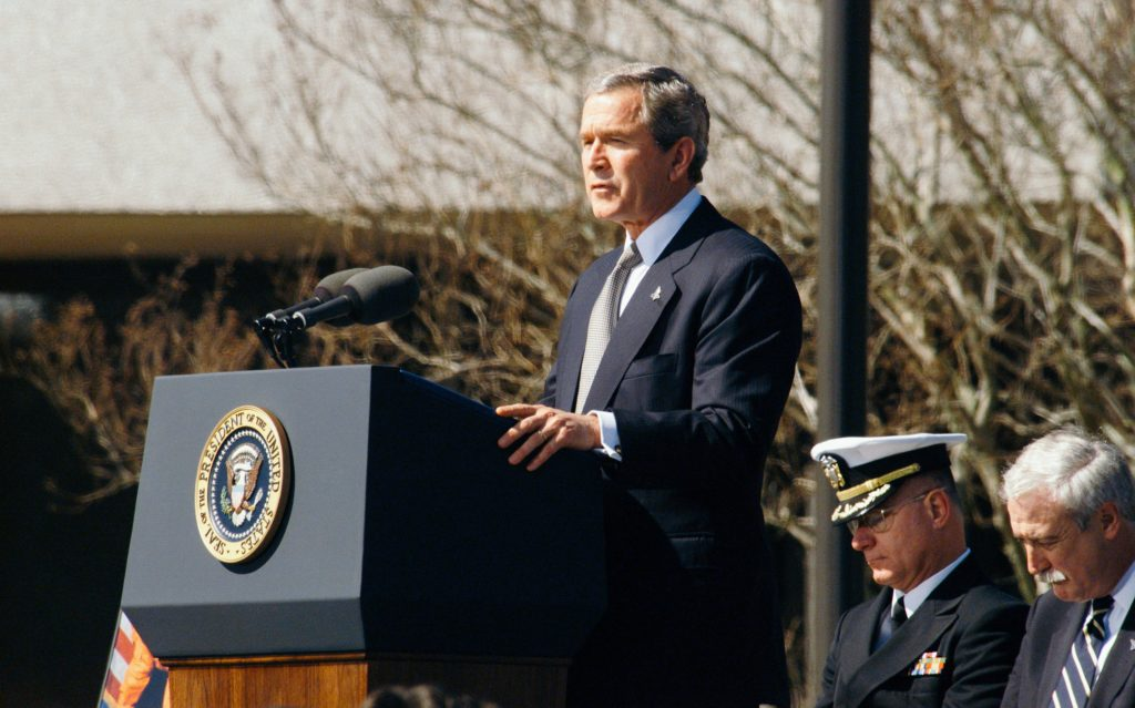 this is the image of former president bush on a speech with the mayor and the city council